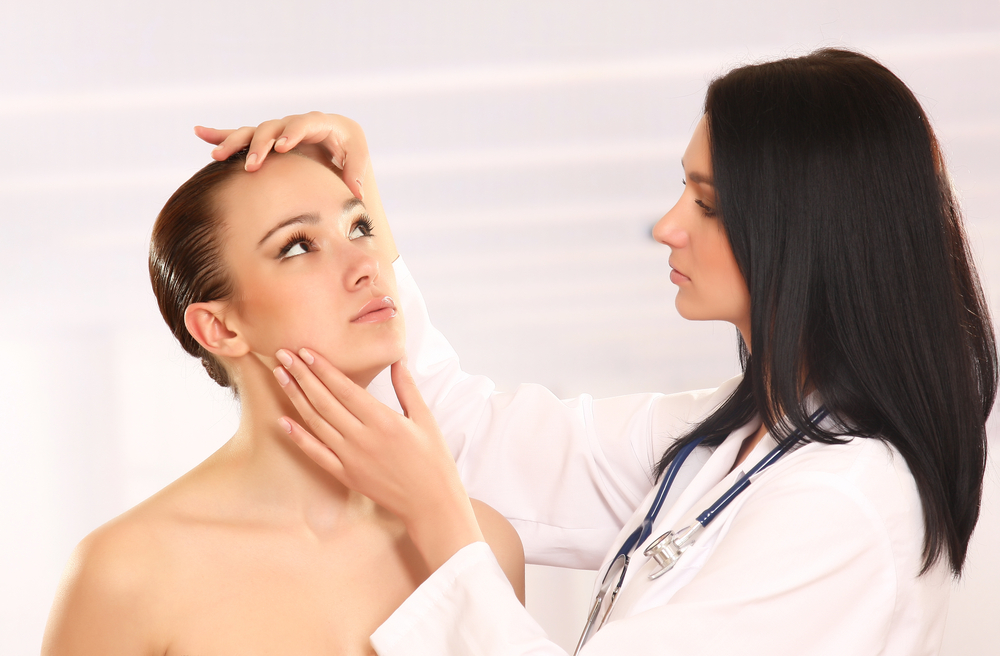 Woman getting her skin examined by a doctor