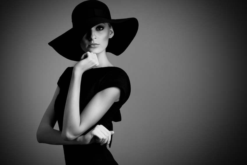 high fashion portrait of elegant woman in black hat