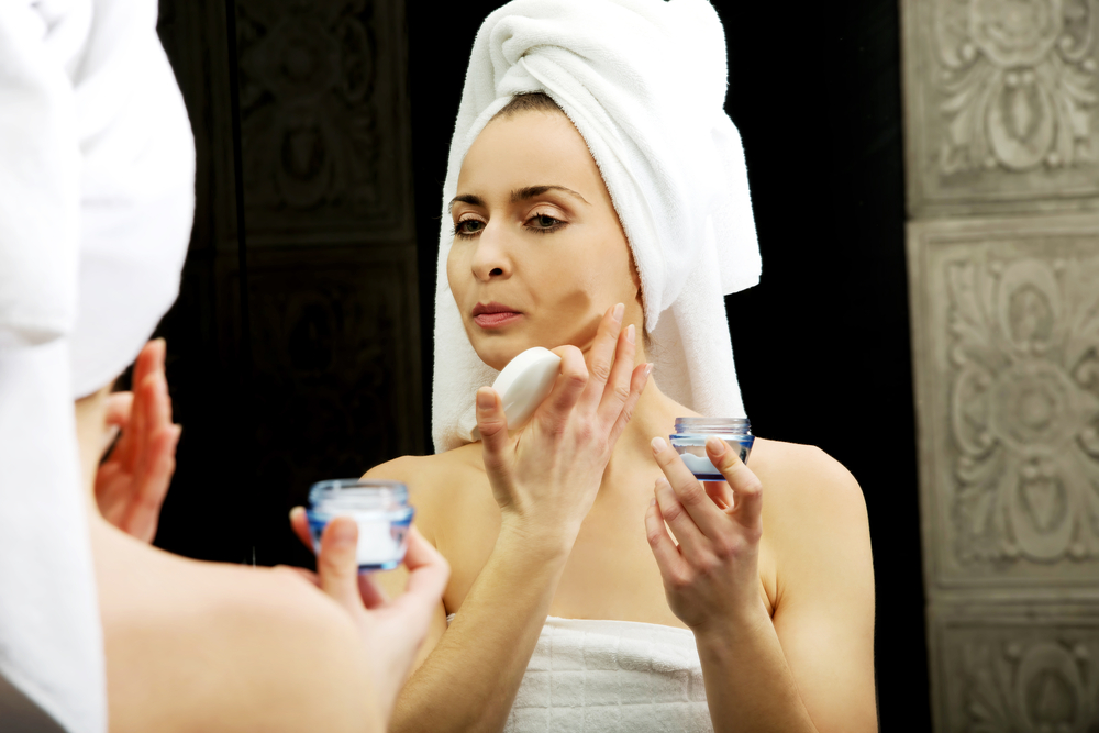 Woman applying a night cream