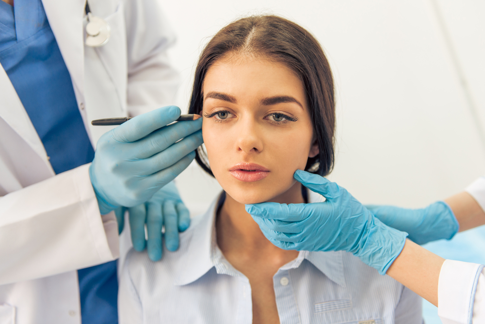 Doctors with Blue Rubber Gloves Examining Woman's Face