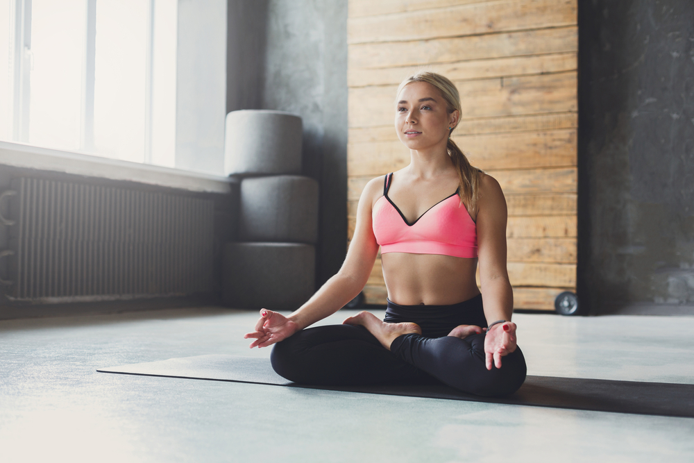 Women Sitting in Cross-Legged Yoga Pose