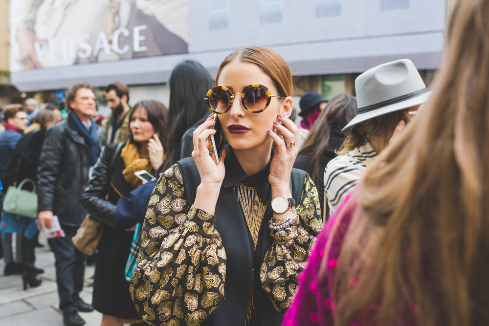 Stylish Woman in Sunglasses on Cell Phone