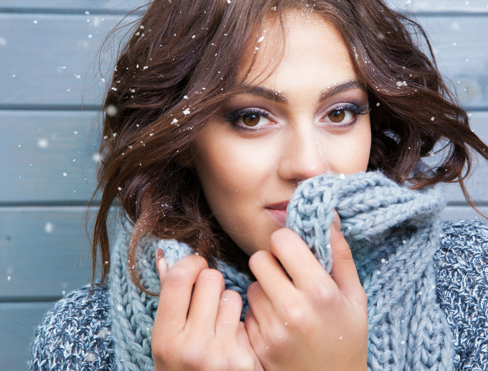 Woman hudling up in a sweater