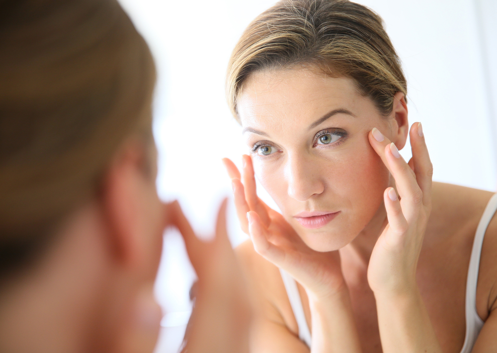 Woman soothing the skin near her eyes