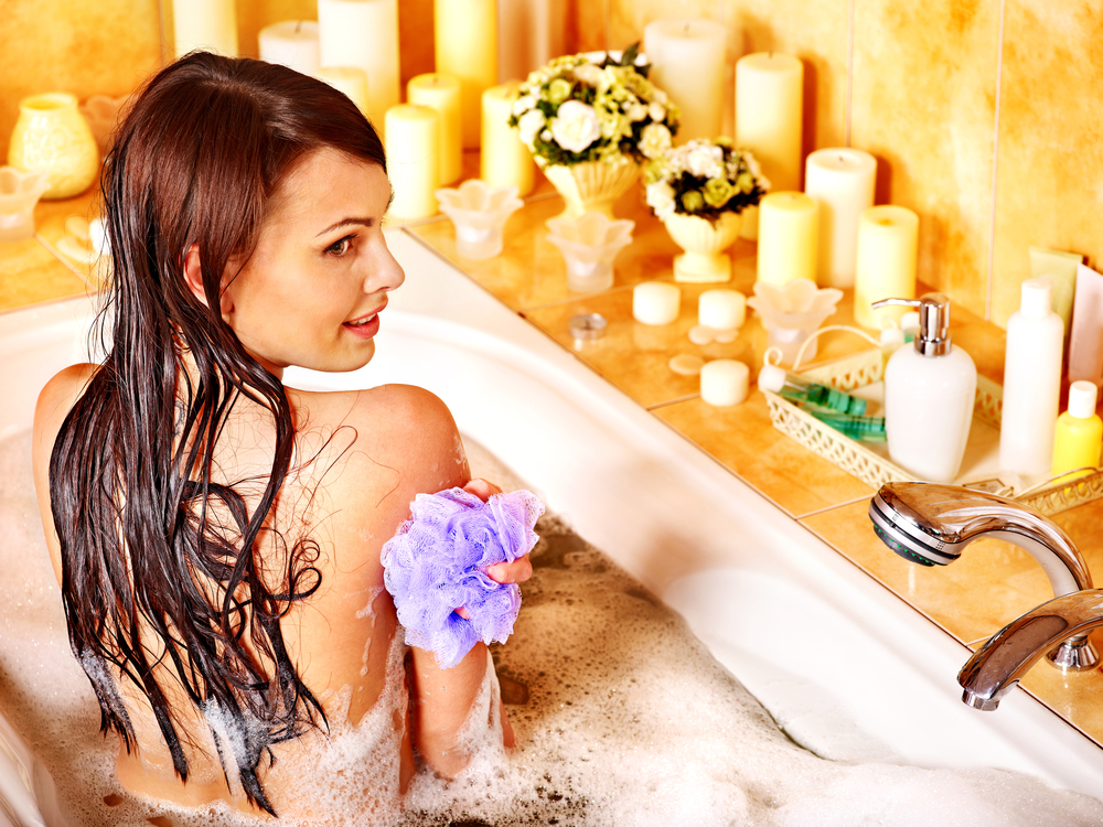 Woman Washing Back in Bathtub