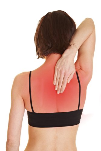 Woman Touching Red, Sunburned Back