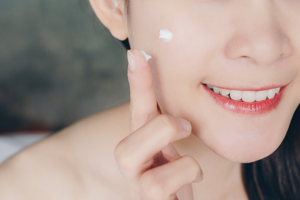 Woman applying spot cream